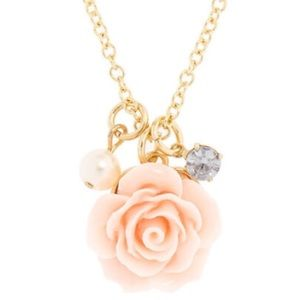 I am selling a pink and gold necklace
